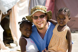 "Josh White '97, with some Haitian children.<a href=""/reason/images/283715_orig.jpg"" title=""High res"">∝</a>"