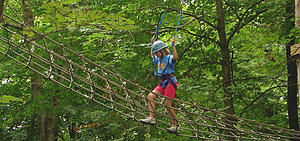 "Teen navigating the High Ropes Course at Lanesboro's Eagle Bluff.<a href=""/reason/images/285696_orig.jpg"" title=""High res"">∝</a>"