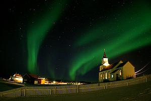 "Northern Lights over Kvaløya; by M. Buschmann, from Wikimedia Commons<a href=""/reason/images/338826_orig.jpg"" title=""High res"">∝</a>"