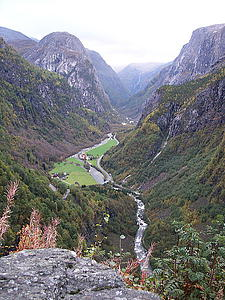 "View of the valley Nærøydalen; the river is Nærøydalselvi, the rounded mountain at the left hand side is Jordalsnuten; by GrafZahl, from Wikimedia<a href=""/reason/images/338874_orig.jpg"" title=""High res"">∝</a>"