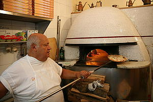 "Woodfired pizza oven at Pizzeria Sorbillo in Naples, by Glen MacLarty, from Wikimedia Commons<a href=""/reason/images/340112_orig.jpg"" title=""High res"">∝</a>"