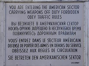 "Historic Sign at the Checkpoint Charlie in Berlin; by Manecke, from Wikimedia Commons<a href=""/reason/images/340562_orig.jpg"" title=""High res"">∝</a>"
