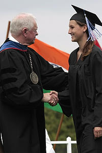 President Torgerson and congratulating grad