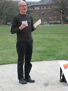 "Muggli introducing the day's sonnets in Bentdahl Commons<a href=""/reason/images/359484_orig.jpg"" title=""High res"">∝</a>"
