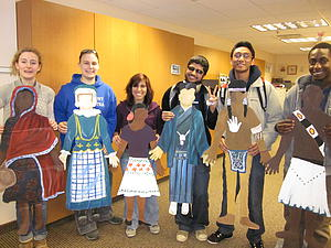 Students pose with world attire.