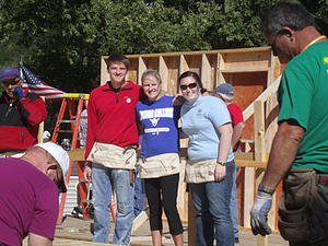 Luther students help build.