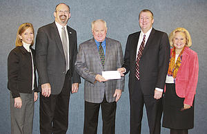 Luther College receives grant from Thrivent Financial, pictured from left to right, Jeanie Lovell, director of corporate and foundation relations and campaign co-director, Keith Christensen, vice president for Development, Luther President Richard Torgerson, Jeffrey Olinger, Thrivent Financial representative, Ann Sponberg Peterson, director of Development, principal gifts.