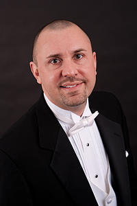Andrew Last, assistant professor of music, and conductor of Collegiate Chorale