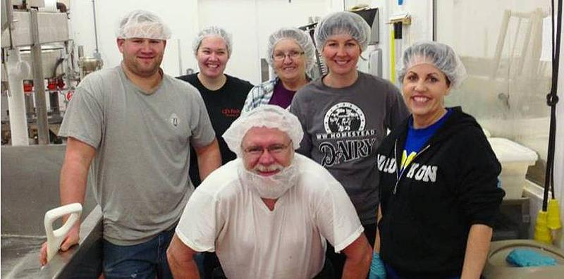 WW Homestead Dairy employees smile for their picture.
