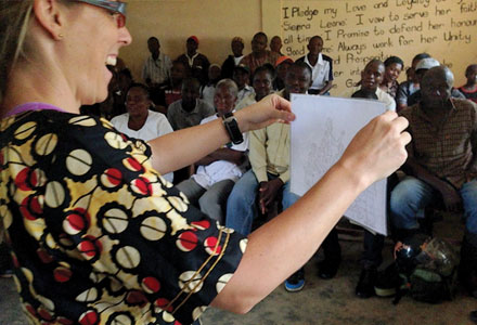 Dynes uses a storytelling approach to train community health workers in Sierra Leone about Ebola transmission, stigma, and discrimination.