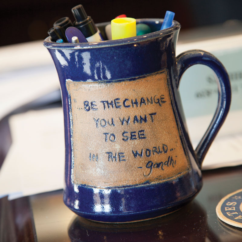 Frank's vast collection of coffee mugs includes one with a quotation that also serves as his computer's screen saver.