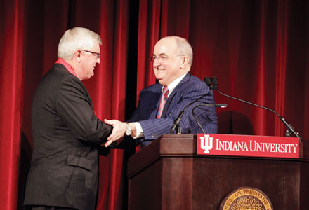 George Kuh '68, left, accepts award from University of Indiana President Michael A. McRobbie. Photo courtesy of the University of Indiana