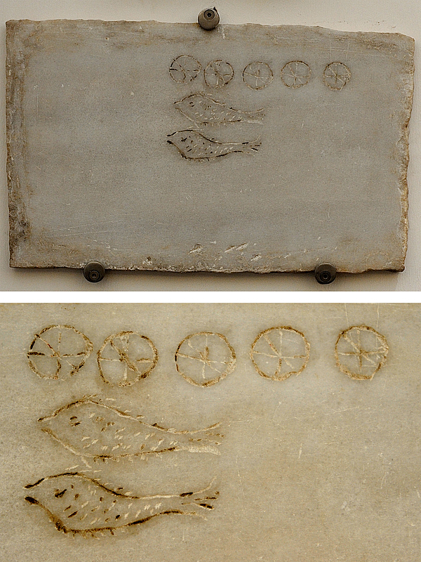 Fig. 3. Marble plaque depicting five loaves and two fish, from the Baths of Diocletian, Rome. Photo by Joshua Nelson.