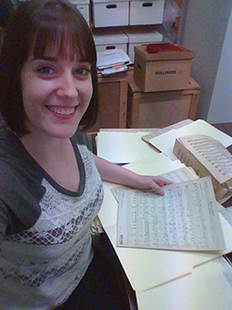 Taylor working with the archives of the Vesterheim Norwegian-American Museum.