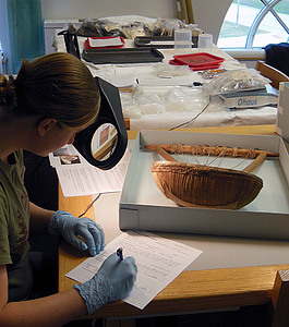 A student worker, Jess Landgraf '14, completes a condition report for an object from our ethnographic collection.