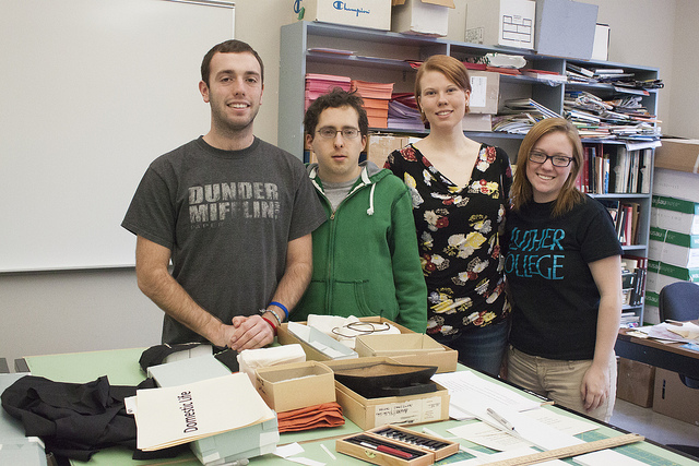 Jason, Nathan, Cailin, and Taylor prepare objects for display.
