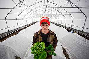 Student gardener, Parker Beard, in the High Tunnel.