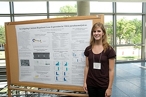 Undergraduate student Aimee Villard presenting her research results at a conference.