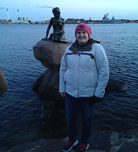 Sarah Hermeier in front of the mermaid statue in Copenhagen.