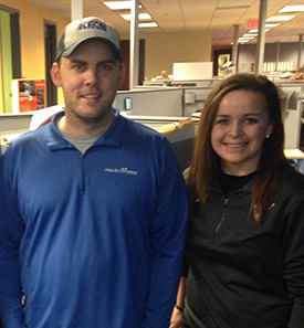 Paige with one of her coworkers during her internship with KFAN.