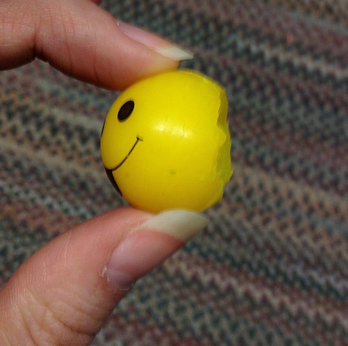 Smiley rubber ball, post-squirrel-attack