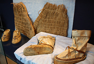 From left to right: Beaded moccasins (Alaska, E950), grass socks (Alaska, E158), and boots (Alaska, E274).