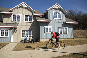 Student preparing to bike from Baker Village to Luther campus.