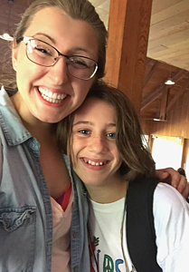 Emily Holm smiles with a camper from Jerusalem during her internship at Kids4Peace