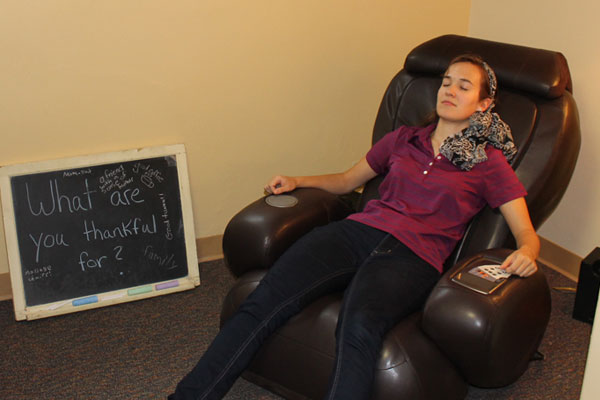 A student relaxing in Health Service's Zen Den.