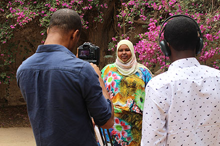 Hoda Hersi '06, project manager, goes on-camera with BBC Media Action.