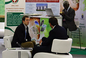Pollan discusses deforestation with a delegate at the 2015 COP21 Climate Conference in Paris.