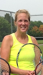 Linnea Benson '95 looks into the camera holding her tennis racket.