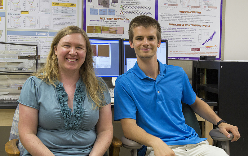 Physics student and faculty member pose for a photo after they completed a collaborative research project together.