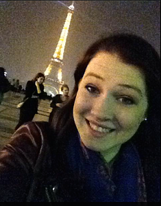Kyla Grau poses at the Eiffel Tower