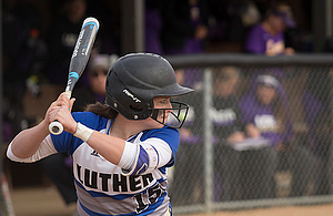 Luther College softball player Paige Lobdell at bat.