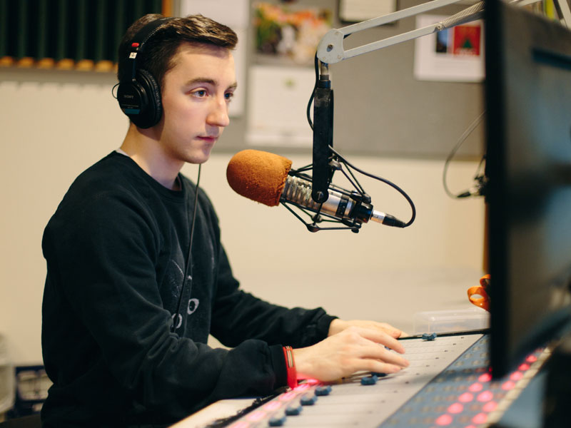 Student hosting a KWLC radio show.