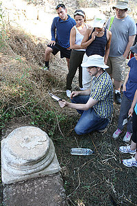 Students make a 3-D photoscan of an ancient column base using an iPad with attached 3-D scanner.