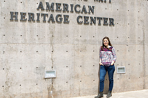 Anita Carrasco stands in front of the American Heritage Center, located at the University of Wyoming. Photo credit: Holly R. Wood, AHC Photographer