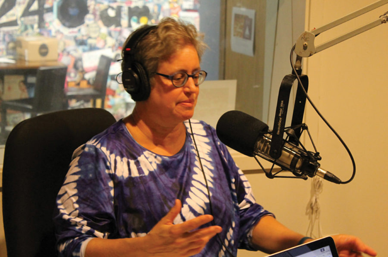 Nancy Barry speaks to her listeners on her KWLC radio show, 'The Naked Page'.