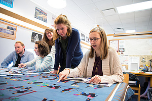 Anthropology student workers are tasked with analyzing and categorizing Luther College's sizable collection of Hmong tapestries and lineages.