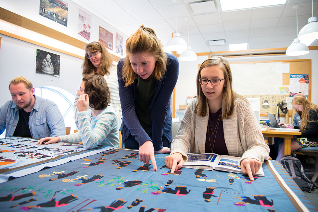 From left to right, Thomas Specht '19, Anthropology Lab manager Destiny Crider, Deanna Grelecki '19, Laura Christensen '18, and Elizabeth Wiebke '19 compare notes on Hmong textiles. Photo by Will Heller '16.