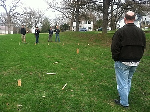 Dr. Pedlar playing Kubb with students at the Physics Picnic.