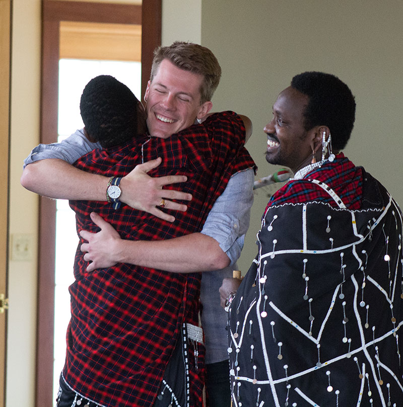 Nearly half of all the particpants in the Tanzania J-term class over the past 15 years returned to Luther to meet again with their Maasai friends. Here, Tyler Crowe '15 greets them.