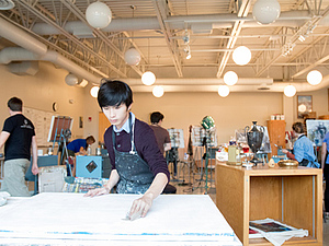 A student prepares for his art project in Ben Moore's Painting class.
