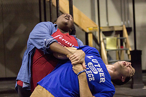 Two students rehearse for Rent the musical.