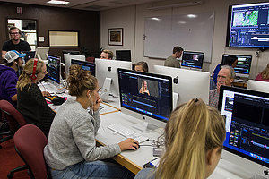 People working on editing their clips during class.
