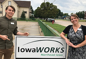 Luther senior Luke Pulliam, with Luther alumna Amy Chicos, at his summer internship with IowaWORKS.