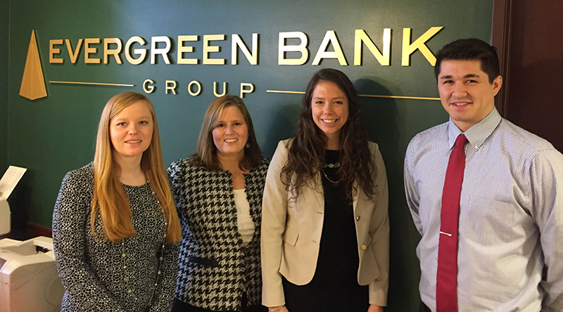 Evan Seegmiller '17, far right, interned with Evergreen Bank Group in Oak Brook, Ill., during January Term 2016 with (left to right) Jenny Voss '07, Jill Wachholz '89, and Kayla Hermann '15. Wachholz is vice president and chief financial officer of the bank.
