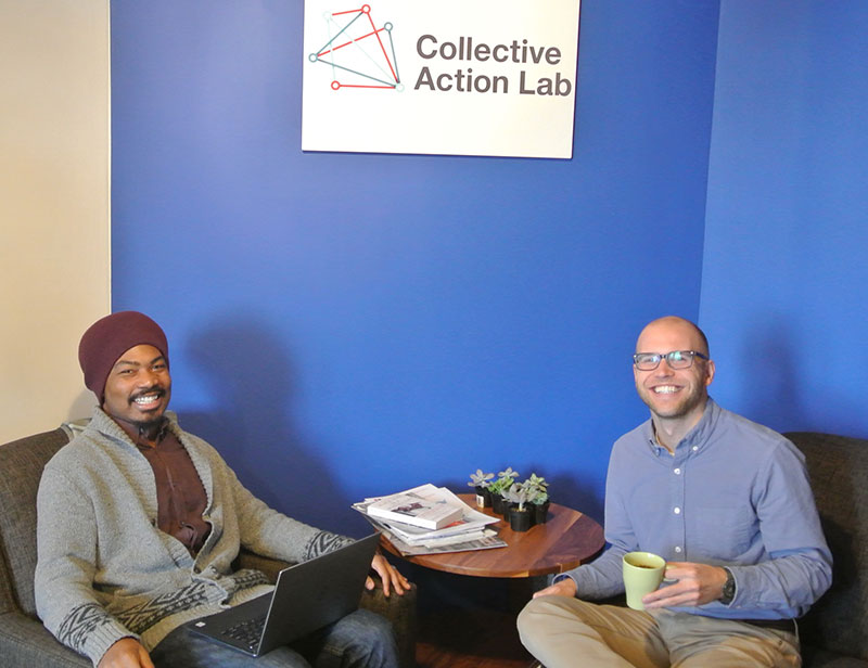 Perran Wetzel V '13 (left) and Ben Kofoed '12 work at the Collective Action Lab, an organization that addresses complex social challenges and facilitates big-picture systemic change.