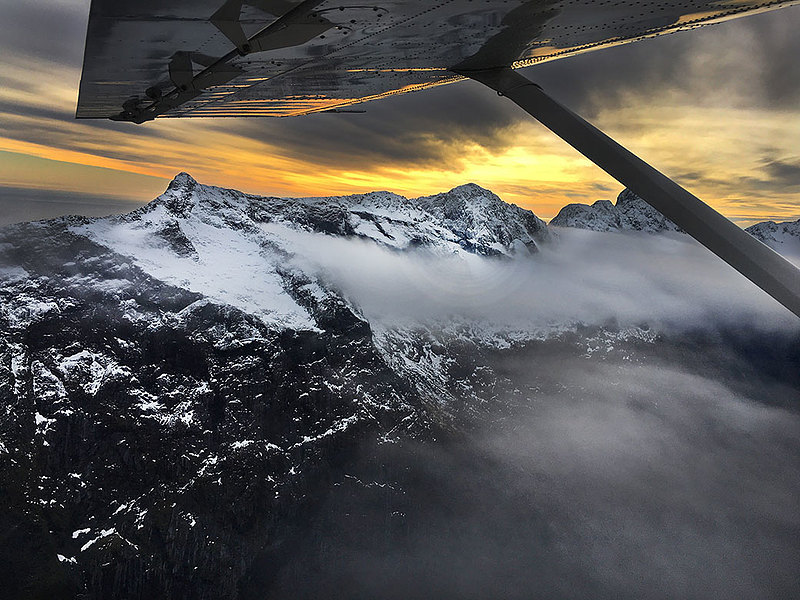 "Hailey Mohler '18 studied in Dunedin, New Zealand, in spring 2017 through Academic Programs International. She writes: ""This photo was taken from an eight-passenger plane flying from Milford Sound to Queenstown. This was easily the coolest experience I had while I was abroad. Flying over the infamous Milford Sound, seeing glaciers up close and personal, and watching the sunset over NZ was something that will never leave me."""